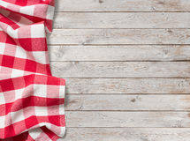 Red picnic tablecloth on white wood background stock photo