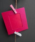 Red picture frame hanging on the ropes Royalty Free Stock Photography