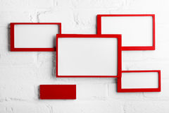 Red picture frame on white wall Stock Images