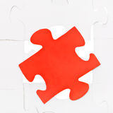 Red piece on free space of connected puzzles Royalty Free Stock Photography