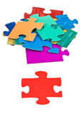 Red piece near pile of jigsaw puzzles Royalty Free Stock Image