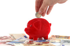Red piggy bank. Piggy bank standing on Euro-banknotes Royalty Free Stock Photos