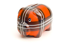 Red Piggy Bank. A red piggy bank isolated on white Royalty Free Stock Photo