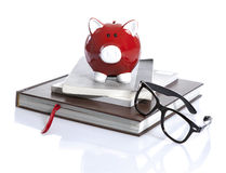 Red Piggy Bank with books Royalty Free Stock Image