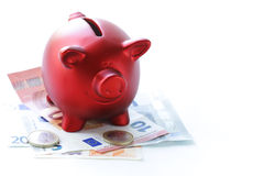 Red piggy bank with euro banknotes Royalty Free Stock Photography