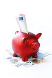 Red piggy bank with euro banknotes Royalty Free Stock Photo