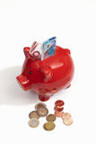Red piggy bank with euro notes and coins Royalty Free Stock Photo