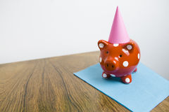 Red piggy bank having a party Royalty Free Stock Image