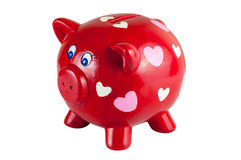 Red piggy bank with hearts Stock Photography