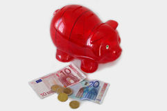 Red piggy bank with money Royalty Free Stock Photo
