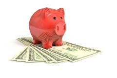 A red piggy bank over dollar notes. 3d rendering of a red piggy bank over dollar notes Stock Photo