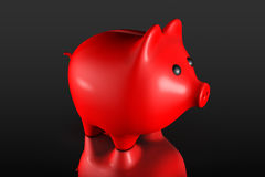Red Piggy bank style money box. On a black background Stock Photography