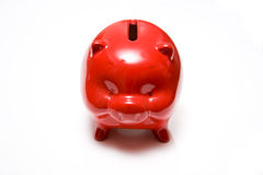 Red piggy bank on white Royalty Free Stock Photo
