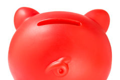 Red Piggy moneybank. A red plastic piggy whit the slot in the back Royalty Free Stock Image