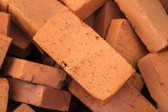 Red pile of bricks for construction site.  Royalty Free Stock Image