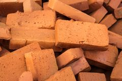 Red pile of bricks for construction site.  Stock Photo