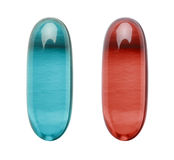 Red Pill Blue Pill. Red and Blue Capsule like those in the matrix isolated on a white background stock photos