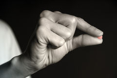 Red Pill - Pill between Fingers Royalty Free Stock Photo