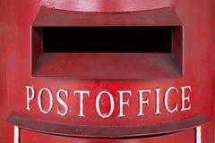 Red Pillar Box. Close up shot of red British pillar box shot from the front Royalty Free Stock Image
