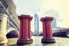 Red pillars for the construction of a bridge Stock Image