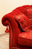 Red pillow. With an ornament on a sofa Royalty Free Stock Photography
