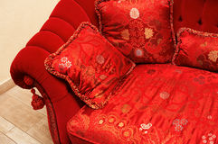 Red pillow. With an ornament on a sofa Stock Photography