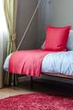 Red pillow and blanket on bed in bedroom Stock Photo