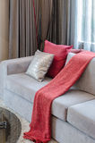 Red pillow on grey sofa in living room Royalty Free Stock Photos