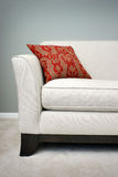 Red Pillow On A Sofa Stock Images