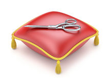 Red pillow with scissors Stock Photo