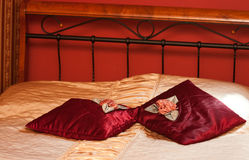 Red pillows on bed. A background of a bed with red pillows Stock Images