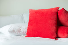Red pillows on a bed.  Stock Photography
