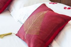 Red pillows on a bed. Close up of red pillows on bed Royalty Free Stock Photography
