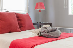 Red pillows with set of crochet on bed in bedroom at home. Red pillows with set of crochet on bed in bedroom Royalty Free Stock Image