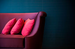 Red pillows on a sofa Stock Image