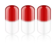 Red pills. On white background. Medication Stock Photography