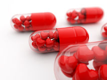 Red pills filled with hearts Royalty Free Stock Photos