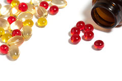 Red pills and medical colored capsules Royalty Free Stock Photos
