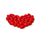 RED pills medicine heart shape  white background Stock Image