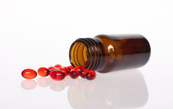 Red pills an pill bottle Royalty Free Stock Photo
