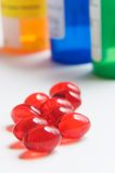 Red pills and prescription bottles Royalty Free Stock Photos