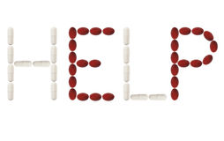 Red and while pills spell Help Royalty Free Stock Images