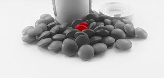 Red pills  in white background cutout color. Red pills  in white background in macro view cutout color Stock Photography