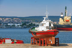 Red pilot boat stands on the pier in Varna Royalty Free Stock Images