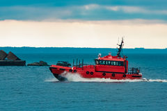 Red pilot ship moving fast Royalty Free Stock Photo