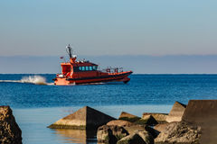 Red pilot ship moving at speed Royalty Free Stock Photos