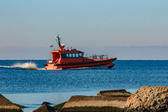 Red pilot ship moving at speed Stock Photos