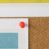 Red pin attachment paper on cork board in office. Royalty Free Stock Image