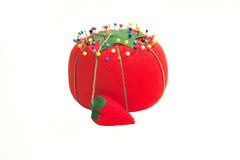 Red pin cushion with pins Stock Images