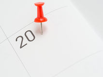 Red pin on 20 date on calendar paper Stock Photography